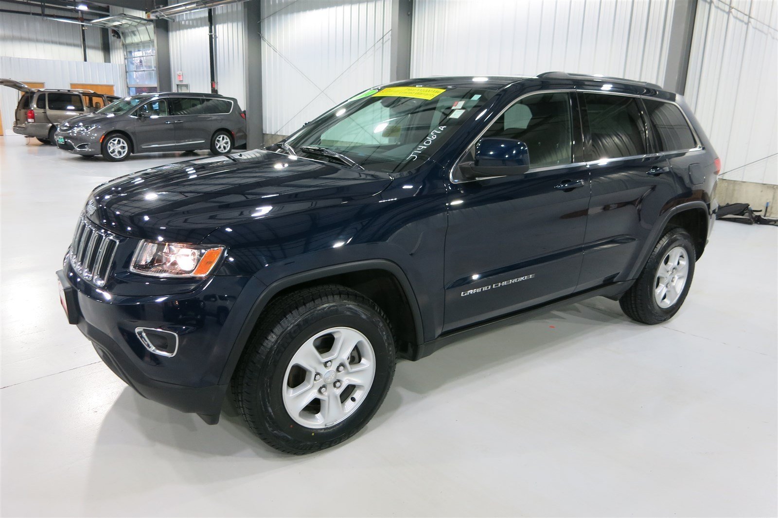 pre owned 2014 jeep grand cherokee laredo sport utility in marshfield j14067a quirk chrysler. Black Bedroom Furniture Sets. Home Design Ideas