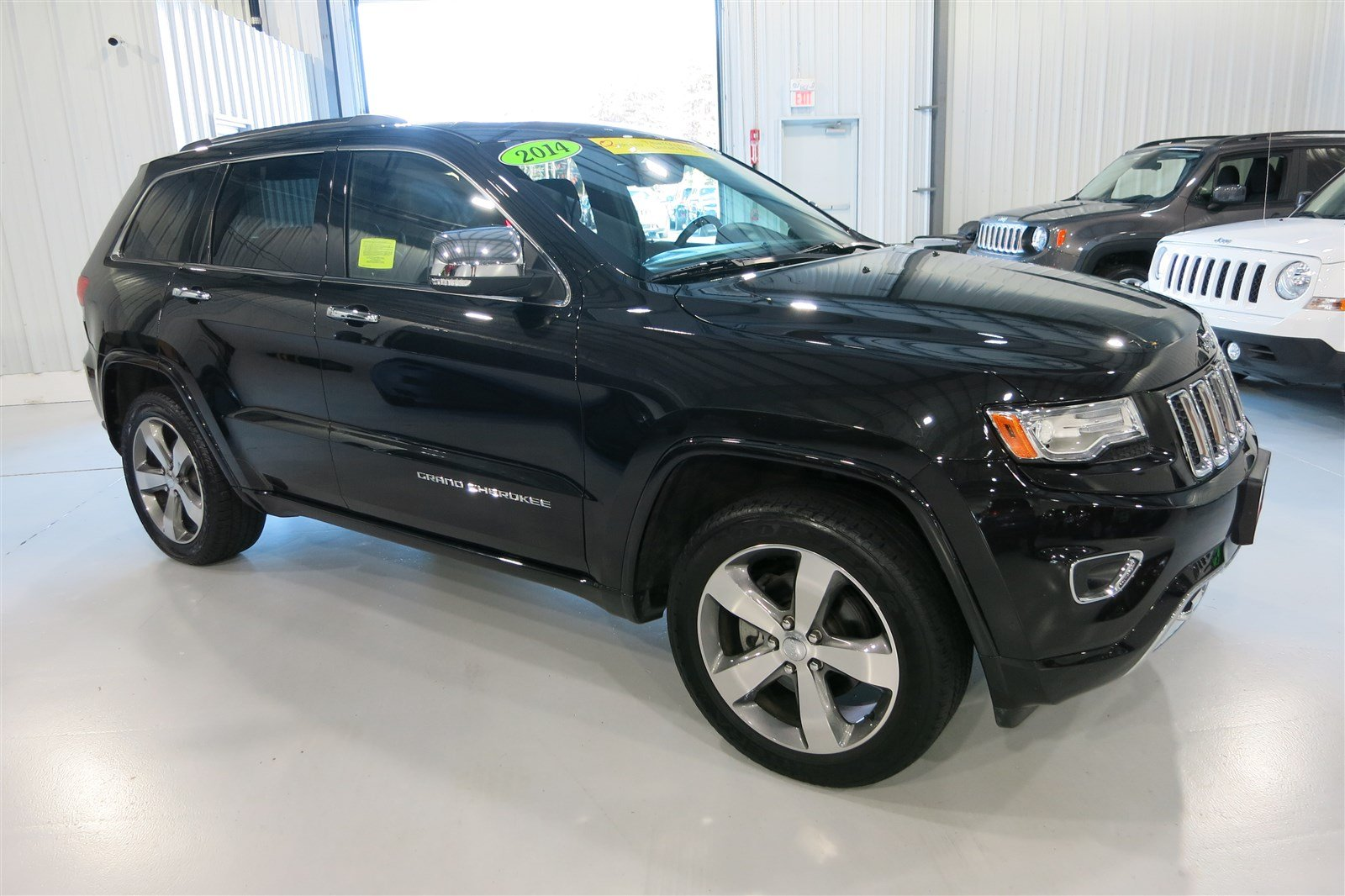 pre owned 2014 jeep grand cherokee overland sport utility in marshfield d4527a quirk chrysler. Black Bedroom Furniture Sets. Home Design Ideas